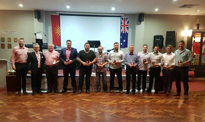 Representatives from participating clubs receiving their plaques