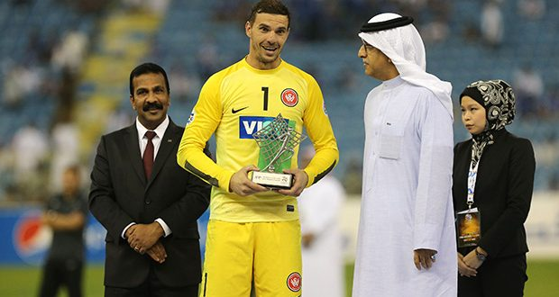RIYADH, SAUDI ARABIA- NOVEMBER 1: Australia's Western Sydney Wanderers goalkeeper Ante Covic receives the fair player trophy after winning the second leg of the AFC Champions League 2014 football final with a 0-0 draw against Saudi Arabia's Al Hilal at the King Fahd stadium in Riyadh, on November 1, 2014. (Photo by Salah Malkawi/ Getty Images)